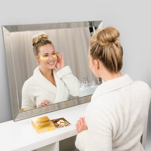 Load image into Gallery viewer, girl looking in mirror wearing under eye mask from care market