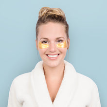 Load image into Gallery viewer, girl wearing gold under eye patches from care market