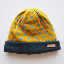 Load image into Gallery viewer, K.Moods Reversible Beanie: bright yellow with blue polka-dot pattern and a navy band.