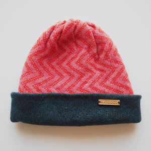 K.Moods Reversible Beanie: bright pink with red zig-zag pattern and a navy band.