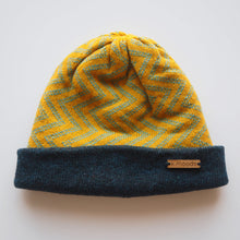 Load image into Gallery viewer, K.Moods Reversible Beanie: bright yellow with blue zig-zag pattern and a navy band.