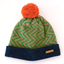 Load image into Gallery viewer, K.Moods Pom-Pom Beanie: bright green with pink zig-zag pattern, a navy band, and an orange pom-pom.