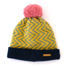Load image into Gallery viewer, K.Moods Pom-Pom Beanie: bright yellow with blue zig-zag pattern, a navy band, and a pink pom-pom.