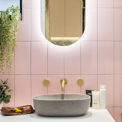 Pink Tiles with gold taps