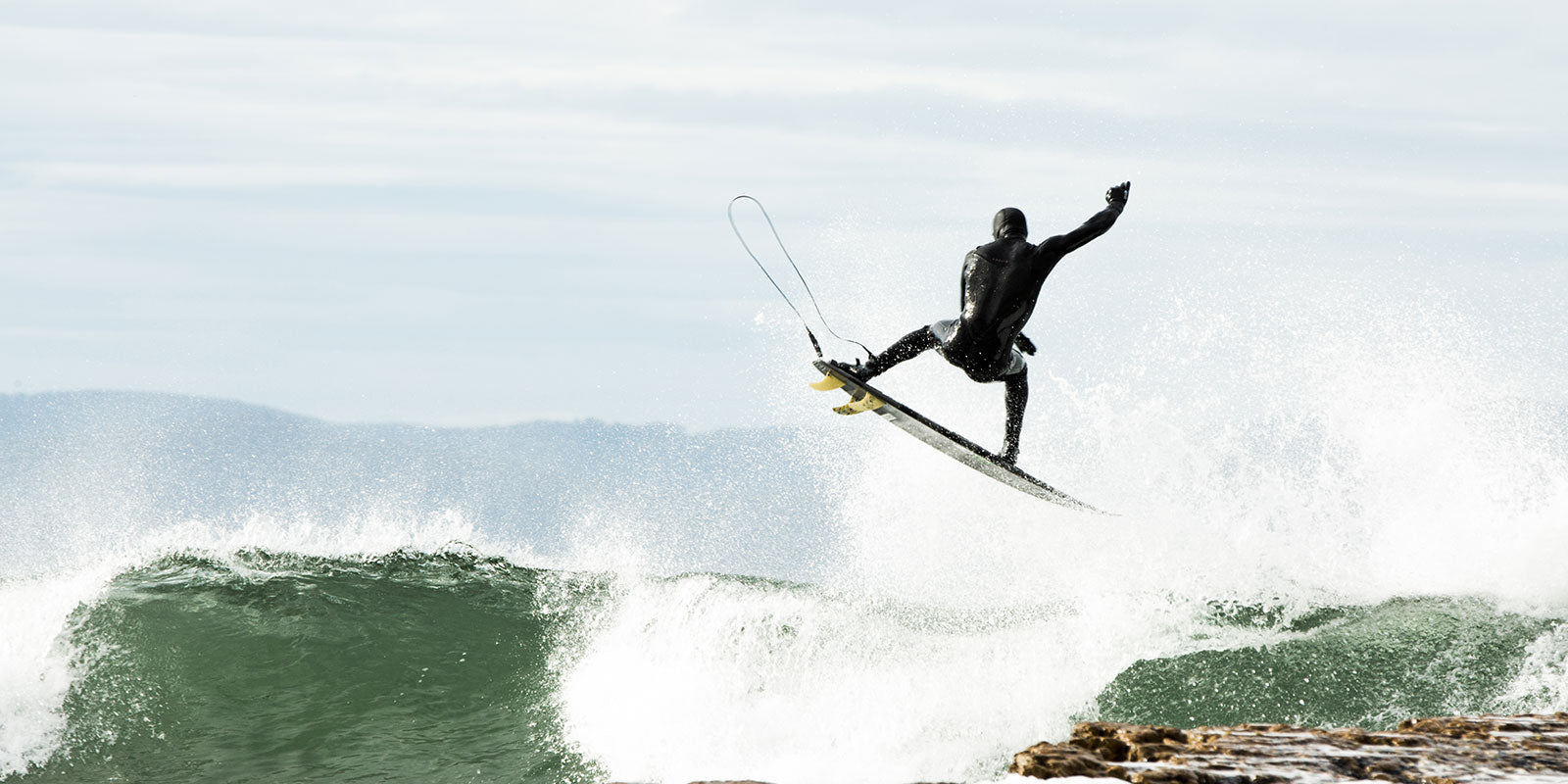 Slyde Handboards Talks Surf Gear & More With Adelio Wetsuits Founder Brett Vergou