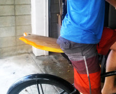 Bike seat the best way to transport your Slyde Handboard