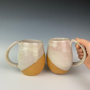 Showing two mugs from the coffee gift set including two angle dipped coffee mugs, one coffee pour over and a matching bud vase. handcrafted, wheel thrown stoneware pottery