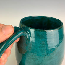 Load image into Gallery viewer, Closeup Angle patterned glaze on Hand crafted, wheel thrown pottery mugs. made on the potters wheel in red stoneware clay, glazed in speckled white or teal green glossy glaze. mugs have a pulled handle that fits full finger grip for most, with thumb groove