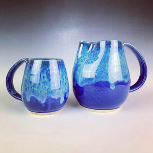 Blue world mug, northwest style coffee mug thrown pottery, with large pulled handle. shown here with matching pitcher