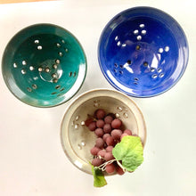 Load image into Gallery viewer, berry colanders, shown in teal, speckled white and cobalt blue. shown for rinsing berries or grapes