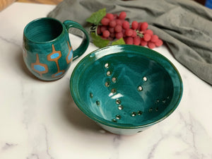 "8"" colander in teal, shown with matching teal MidMod Mug."