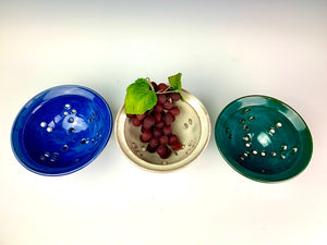 berry colanders, shown in Cobalt Blue, speckled white and teal. shown for rinsing berries or grapes