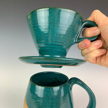 Load image into Gallery viewer, Detail shot of bottom of Coffee pour over and drip edge. wheel-thrown pottery, white glaze with speckled white glaze. shown with matching mug in Teal.