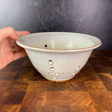 "Load image into Gallery viewer, A wheel thrown pottery colander in speckled white glaze. 8"" diameter colander"