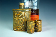 Load image into Gallery viewer, matching lumberjack flask and shot glasses. shown with bourbon in background