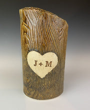 Load image into Gallery viewer, wood grain textured vase, appears like a tree thrunk with a heart caved into it and initials carved into the heart.
