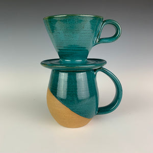 Coffee pour over, wheel-thrown pottery, in Teal glaze, shown with matching Teal, angle dipped mug