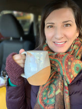 Load image into Gallery viewer, Fern Street Pottery's Meredith, holding her northwest contemporary style, angle dipped mug. White glaze, angle dipped, on red clay.