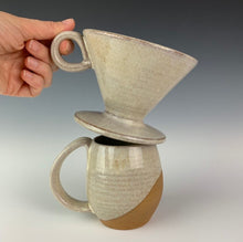 Load image into Gallery viewer, showing the pour over and one mug from the coffee gift set including two angle dipped coffee mugs, one coffee pour over and a matching bud vase. handcrafted, wheel thrown stoneware pottery