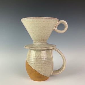 showing one mug and pour over from the coffee gift set including two angle dipped coffee mugs, one coffee pour over and a matching bud vase. handcrafted, wheel thrown stoneware pottery