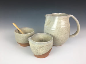 pottery cream and sugar set with bamboo spoon,  shown with matching pottery pitcher. Red clay, white speckled glaze.