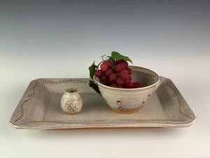 Pottery Berry colander in speckled white on red clay. shown with matching platter and bud vase