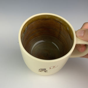 the interior of the sasquatch mug, showing the mottled brown glaze