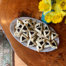 "Load image into Gallery viewer, Oval serving platter (16.5"" x 9.5"") in carved speckled white with Hamentashen cookies"