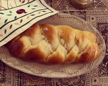 "Load image into Gallery viewer, Oval serving platter (16.5"" x 9.5"") in carved speckled white as a Challah platter"