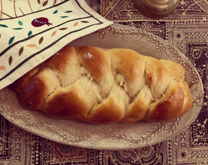 "Oval serving platter (16.5"" x 9.5"") in carved speckled white as a Challah platter"