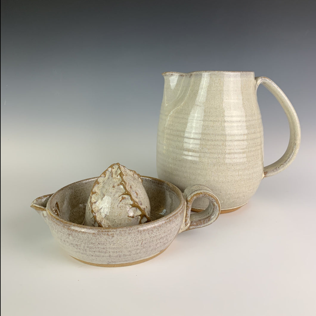 Pottery Citrus juicer, thrown on the wheel in red clay, glazed in speckle white. shown with matching pitcher.