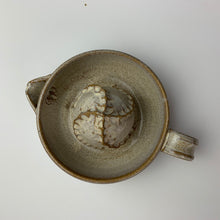 Load image into Gallery viewer, Pottery Citrus juicer, thrown on the wheel in red clay, glazed in speckled white. shown from above to show texture on dome