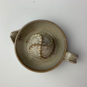 Pottery Citrus juicer, thrown on the wheel in red clay, glazed in speckled white. shown from above to show texture on dome