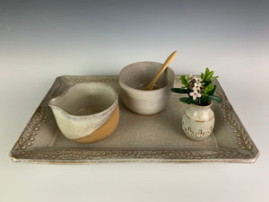 cream and sugar set with bamboo spoon, shown on a matching pottery tray with a carved edge and a sweet bud vase