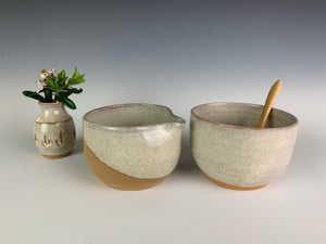 cream and sugar set  in red stoneware pottery and white glaze. with bamboo spoon, and a sweet bud vase