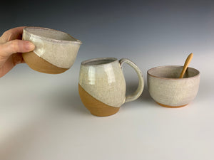 cream and sugar set  in red stoneware pottery and white glaze. with bamboo spoon, shown with a matching angle dipped pottery mug