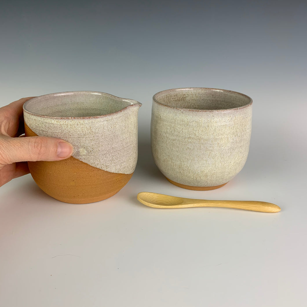 cream and sugar set  in red stoneware pottery and white glaze. with bamboo spoon