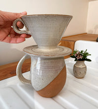 Load image into Gallery viewer, Coffee pour over, wheel-thrown pottery, white glaze with speckles. shown with angle dipped, northwest mug and carved bud vase