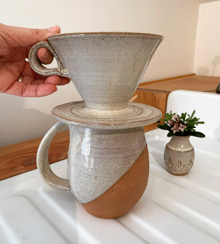 Coffee pour over, wheel-thrown pottery, white glaze with speckles. shown with angle dipped, northwest mug and carved bud vase