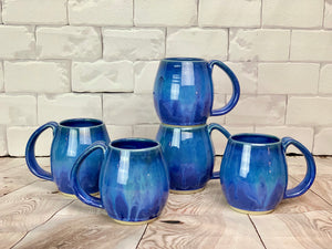 A collection of Blue World Mugs. each one is a little different, but they are well matched.