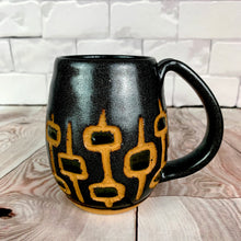 Load image into Gallery viewer, MidMod carved Mugs Freshly made with vintage inspired design and color. black glittery glaze with silvery black round square pattern