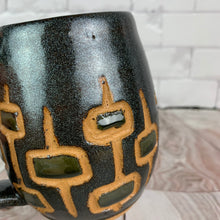 Load image into Gallery viewer, MidMod carved Mugs Freshly made with vintage inspired design and color. Black glittery glaze with silvery black, round square pattern