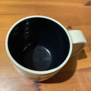 A custom mug shown with black glaze upgrade inside.