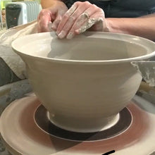 Load image into Gallery viewer, potter throwing a large bowl on the wheel, to be made into a colander.