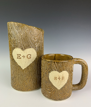 Load image into Gallery viewer, customized version of lumberjack vase and mug with initials and heart carved into woodgrain texture