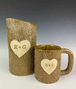 customized version of lumberjack vase and mug with initials and heart carved into woodgrain texture