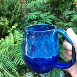 "northwest mug in ""blue world"" glaze, shown in the PNW outdoors"