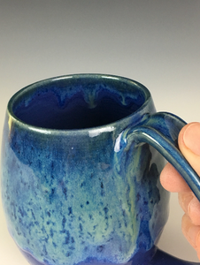 Blue world mug, northwest style coffee mug thrown pottery, showing pulled handle and thumb groove