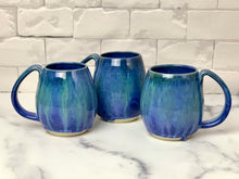 Load image into Gallery viewer, Blue World mugs, blue glaze with melty turquoise blue and green glaze. each one is different. northwest style coffee mug thrown pottery, with large pulled handle.