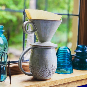 Coffee pour over with finger loop handle, wheel-thrown pottery, white glaze with speckles